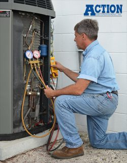 Action Air Conditioning service technician checking freon levels.